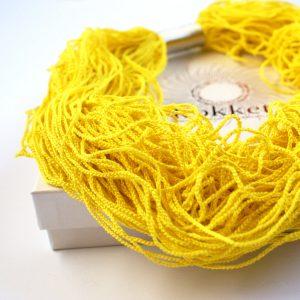 Illuminating gelbe Statementkette von Kokket